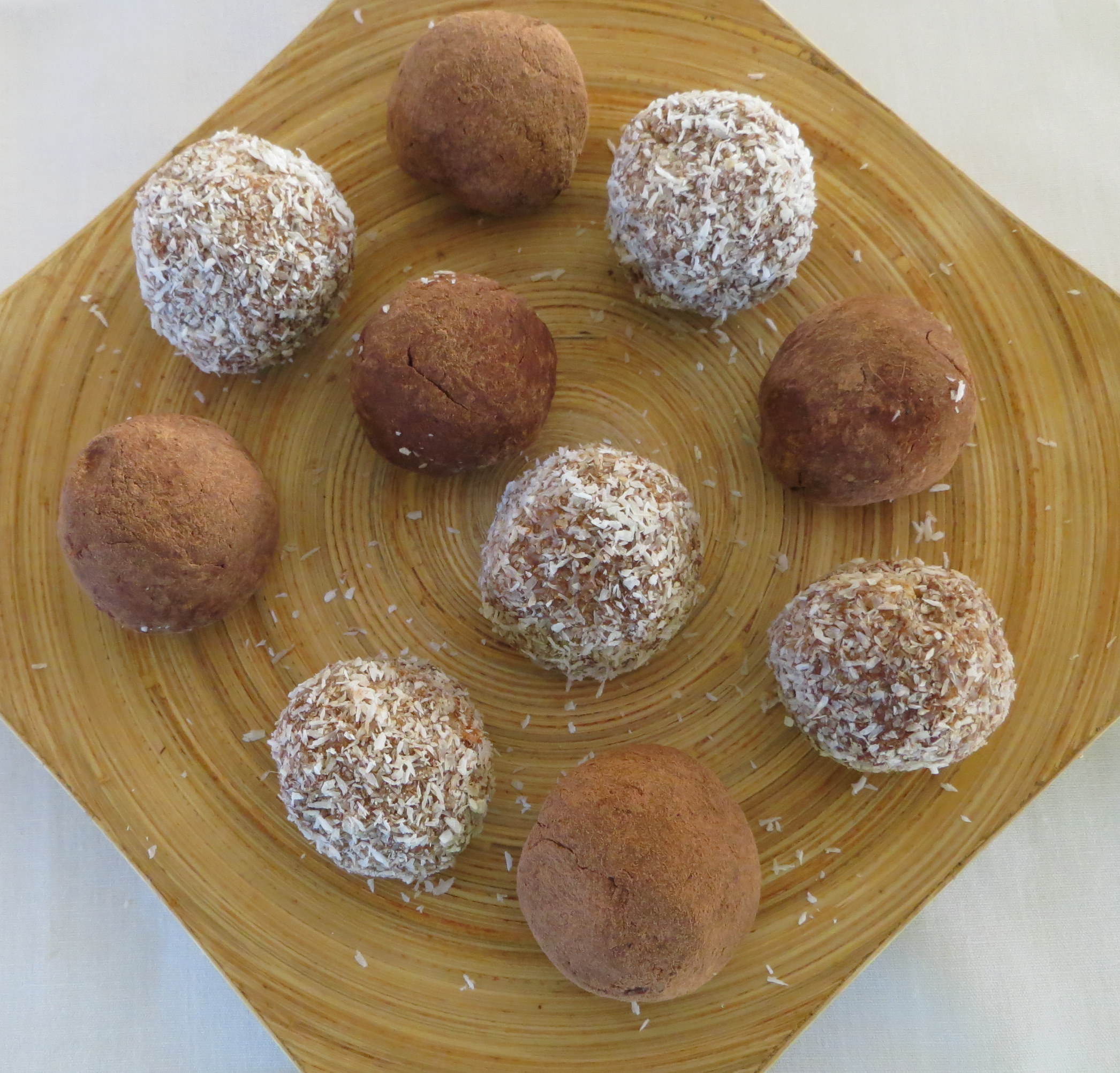 Mango and cocoa  truffles in a plate
