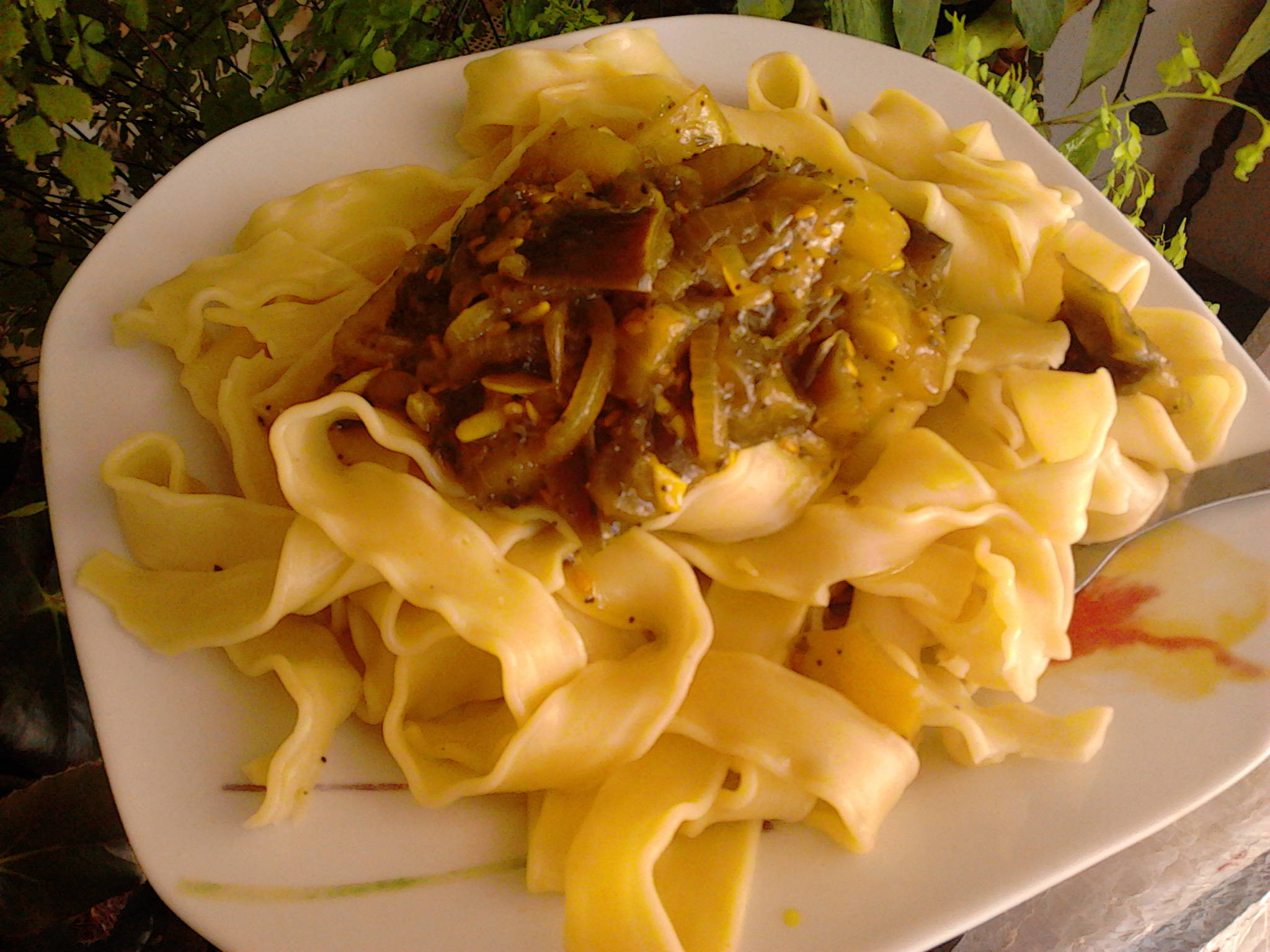Tagliatelle with vegetables on the plate
