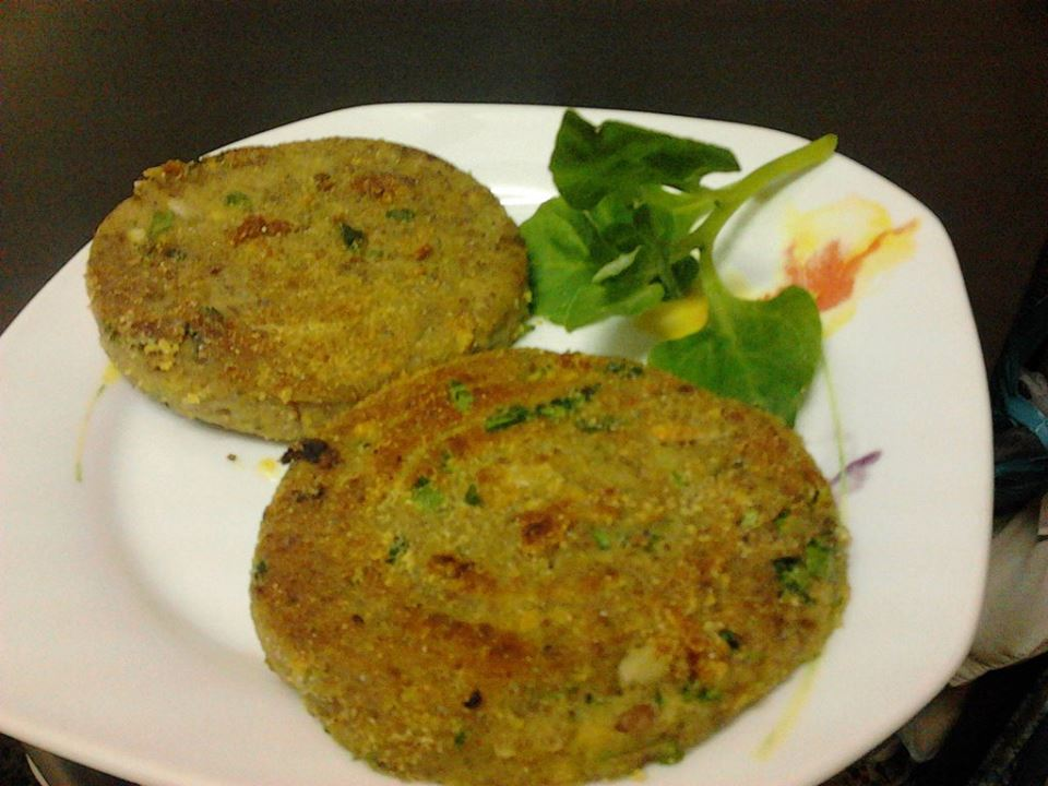 Almond medallions with parsley on a plate.