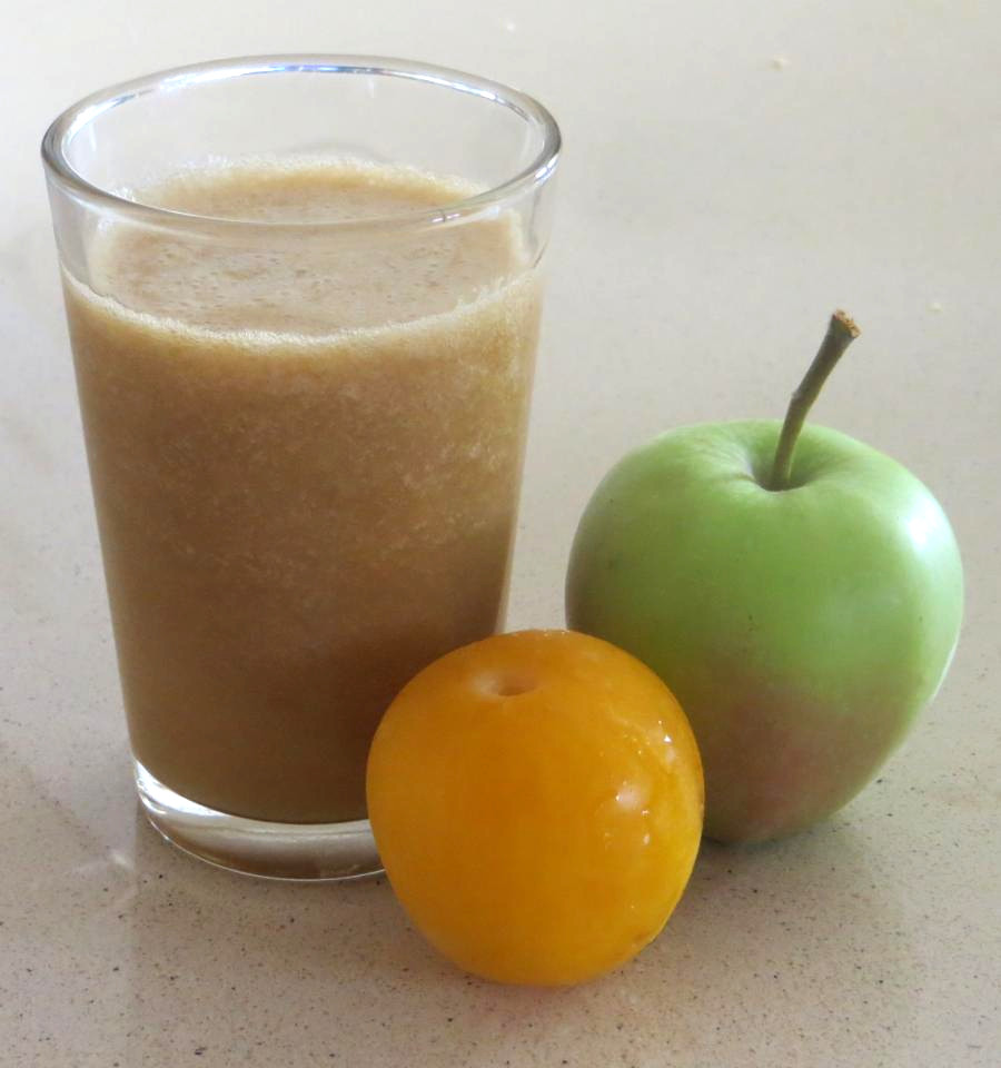 Cup with apple and plum juice, with some cinnamon.