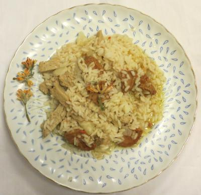 Dish with carqueja and seitan rice with a sprig of gorse