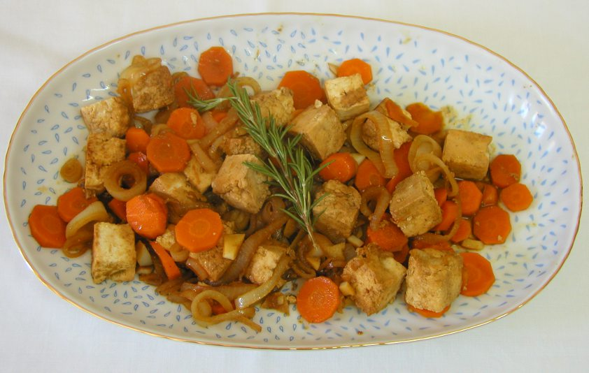 Platter of sautéed tofu with carrot