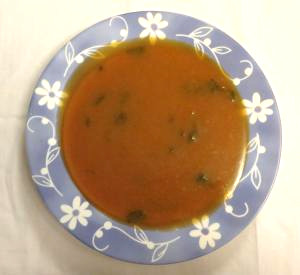 Plate of vegetable and amaranth soup
